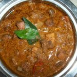 Varutharacha Mushroom Kulambu ( Mushroom Cooked in Roasted Coconut and Whole Spices)
