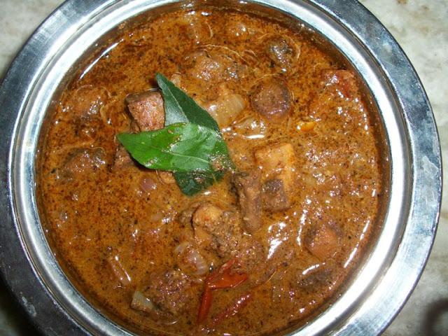 Varutharacha Mushroom Kulambu ( Mushroom Cooked in Roasted Coconut and Whole Spices)