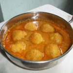 Paruppu Urundai Kulambu (Kuzhambu) / Lentils Dumplings cooked in a Spicy Coconut Sauce – Denser Dumplings Version