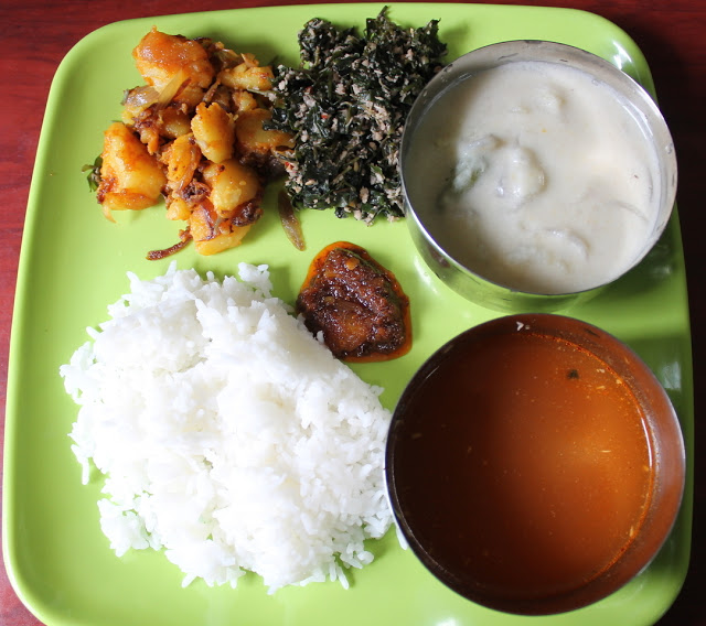 Lunch Menu 7 – Tirunelveli Sodhi, Spinach Thoran, Potato Roast, Rasam & Onion Pickle